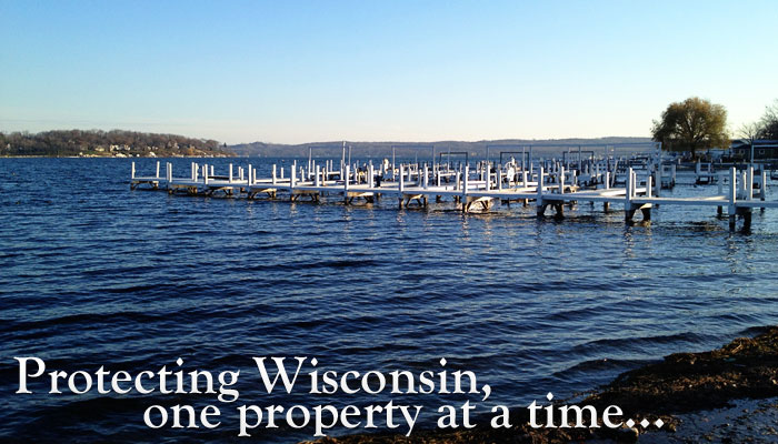 image of a pier with the text Protecting Wisconsin, one property at a time over the image